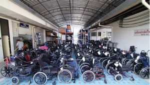 At RICD's warehouse, hundreds of donated wheelchairs wait for distribution.