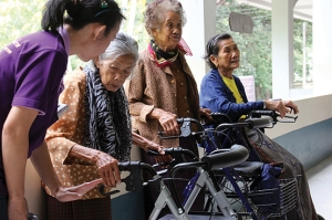 Local elderly women are trained to use their new equipment by RICD's volunteer technicians.