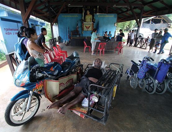 This man broke his neck ten years ago in a motorbike accident and became a C-level quadriplegic, unable to move until he received his first wheelchair from RICD.